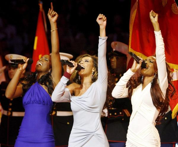 Destiny's Child (Kelly Rowland, left, Beyonce Knowles and Michelle Williams) are seen performing the national anthem before the start of the 2006 NBA All-Star game at the Toyota Center in Houston.