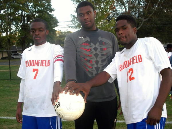Bloomfield boys soccer players  after a 3-0 win over E.O.Smith in Bloomfield this past Mon. Oct. 1. Fabian Burnett (left) scored two goals, Jalon Bryan, the goalie registered five saves and Tajay Robinson scored a goal.