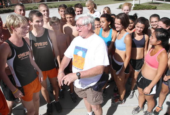 Oviedo cross country and track coach Tom Hammontree is surrounded by his runners in early October. (George Skene, Orlando Sentinel, Oct. 24, 2012)