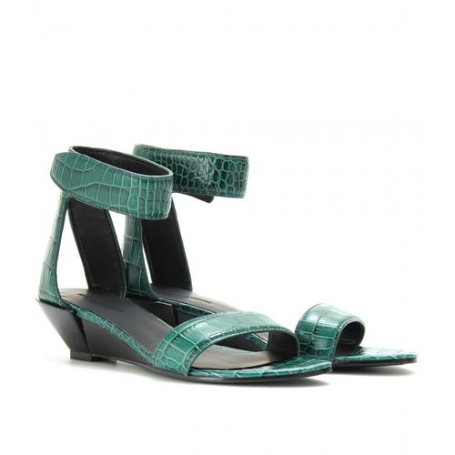 "<p>The Alexander Wang Vika Croco embossed wedge sandals, $743 from <a href=""http://www.mytheresa.com/us_en/vika-croco-embossed-wedge-sandals-186881.html "">MyTheresa.com</a> are perfect paired with cigarette pants or print dresses for spring.</p>"
