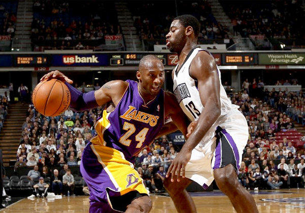Kings guard Tyreke Evans, right, guards Kobe Bryant earlier this season. Bryant is doubtful for the game Sunday.