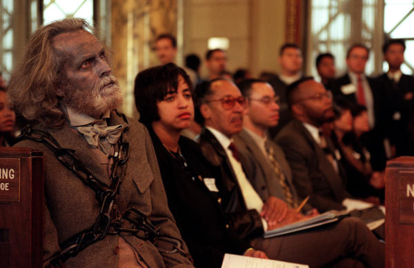 "Actor David Clennon, dressed as the Ghost of Jacob Marley, left, waits to warn Mayor Richard Riordan to stop opposing the pending living wage ordinance in December 1996. Clennon, an Academy of Motion Picture Arts & Sciences member, is now taking action against ""Zero Dark Thirty."""