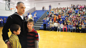 Returning sailor surprises Shearer Elementary students