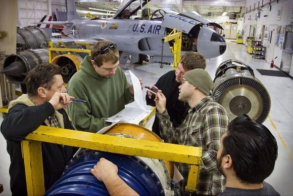 Instructor David Bowerman huddles with students around a J-34 jet engine at the aviation mechanics school at North Valley Occupational Center-Aviation Center at Van Nuys Airport in December.