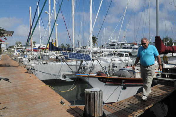 "Harry Powell, 76, has been living on his boat ""Hatches"" for about 20 years. He splits his time between the Royal Palm Basin in Dania Beach and Bermuda.  Powell walks away from this boat to go to Home Depot in Dania Beach."