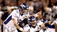 Peyton Manning flaps his arms, stamps his foot and plays traffic cop, sending Denver Broncos teammates this way and that. All the while, the play clock is winding down.