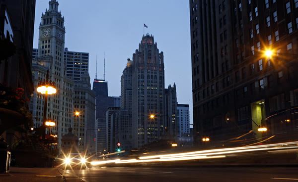 Vehicles speed along Michigan Avenue in front of Tribune Tower.
