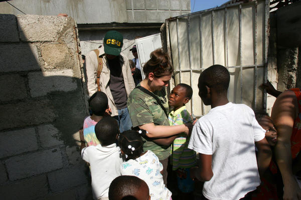 Abbie Tuffs greets kids as she arrives at Aaron Jackson's orphanage in Port-au-Prince.