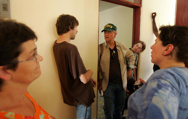 "(L to R) Trisha Comfort, Aaron Jackson, Rabbi Allan Tuffs, his daughter Abbie Tuffs, and Sharon Tennenhaus discuss the situation at Jackson's new orphanage. <br></br>They hope the trip will result in the sponsorship of one or more orphanages in Haiti, which has one of the highest rates of HIV infection in the world.  Both became aware of the situation in Haiti after reading the South Florida Sun-Sentinel's four-part series, ""AIDS Orphans."""