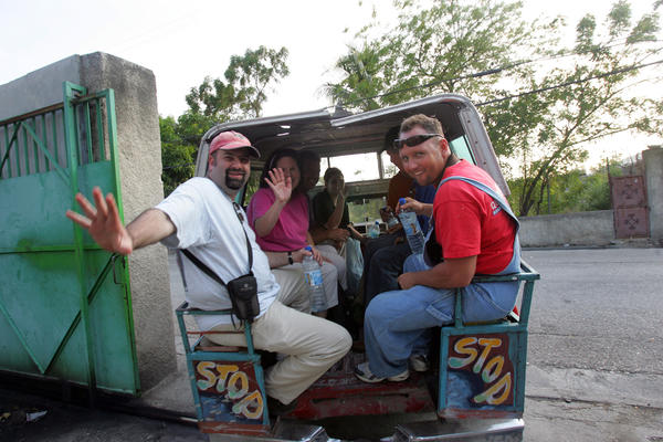 (left) The Rev. Kennedy McGowan and  Gerald Little, a Miami-Dade County firefighter, along with others traveled the streets of Port-au-Prince in a tap-tap.