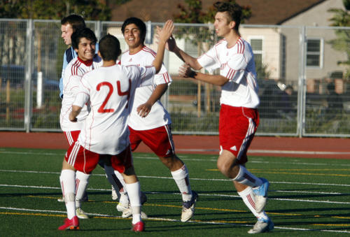 Burroughs' soccer players give each high fives after making a point during a game against CV at John Burroughs High School in Burbank on Friday, June 11, 2013.