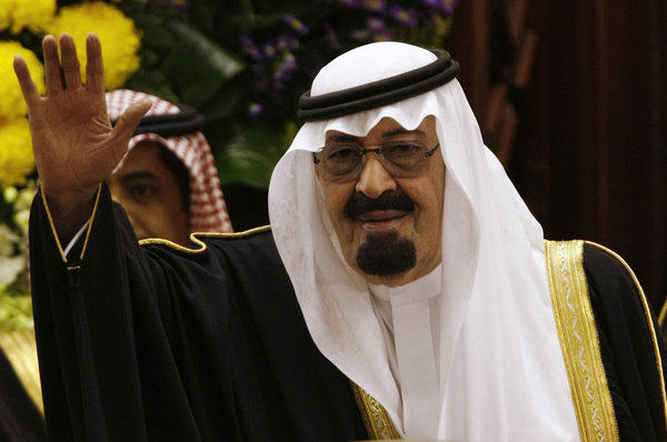 King Abdullah of Saudi Arabia, seen in 2009, waves to members of the Saudi Shura Council in Riyadh, Saudi Arabia.