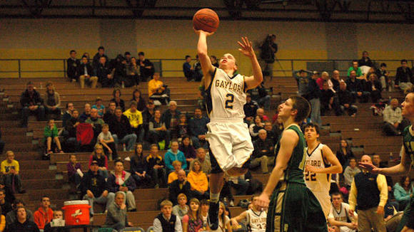 Tyler Cherry gets some hang time while netting two of his seven points during Gaylord's loss to TC West on Friday.