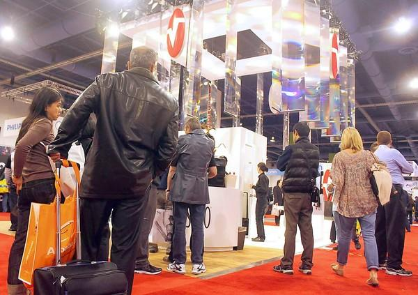 Attendees peruse the Masimo booth at the 2013 CES.