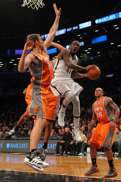 Brooklyn Nets guard Tyshawn Taylor (41) drives the land on Phoenix Suns forward Luke Zeller (40) during the fourth quarter of their NBA game at Barclays Center.