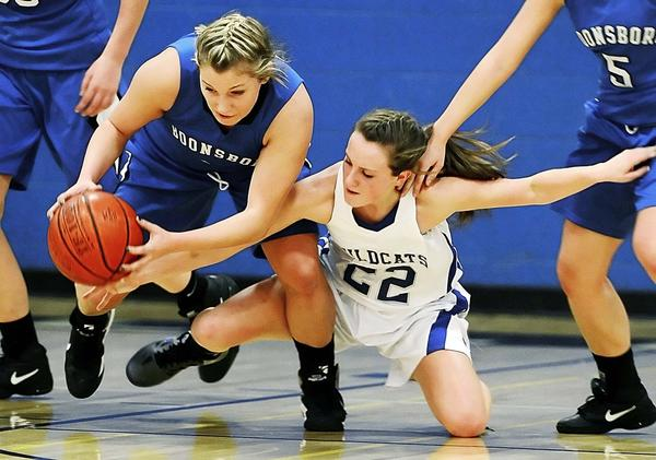 Boonsboro's Katie Sheridan, left, grabs a loose ball away from Williamsport's Kate Wade (22) during the first quarter of Friday night's MVAL Antietam girls basketball game at Williamsport.