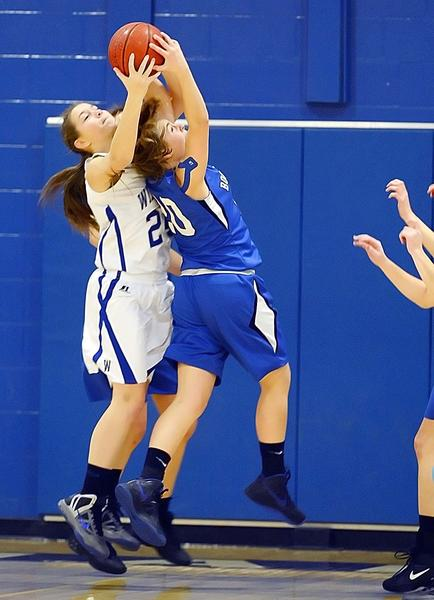 Willamsport's Carley Robinson, left, and Boonsboro's Claudia Jenkins battle for a rebound in the first quarter of Friday night's MVAL Antietam girls basketball game at Williamsport.