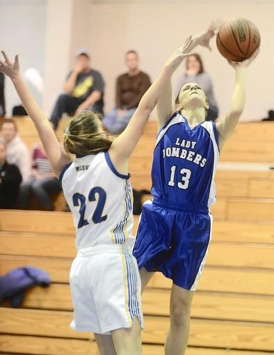 Palmerton #13 Jade Farquhar is defended by Wilson #22 Ariana Caiati in their girls basketball game held at Wilson High School on Friday.