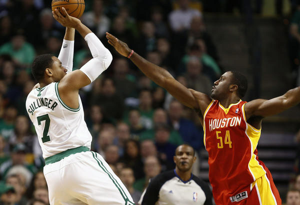 Boston Celtics power forward Jared Sullinger (7) shoots the ball against Houston Rockets power forward Patrick Patterson (54) during the first half at TD Garden.