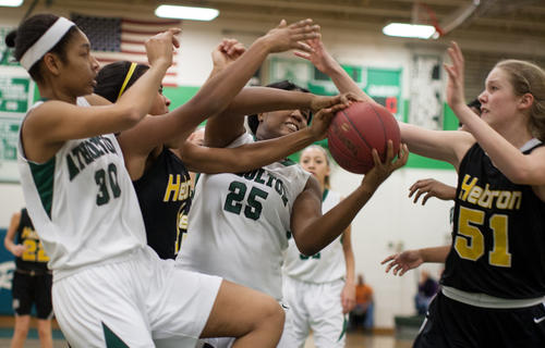 From left, Atholton's Kalere Caldwell, Mt. Hebron's Nia Crump, Atholton's Briana Taborn and Mt. Hebron's Peyton LeConte fight for a rebound.