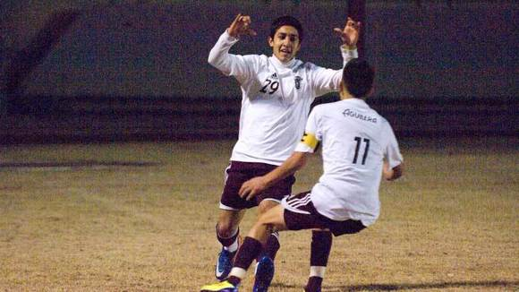Calexico High's Kevin Campos (left) celebrates with teammate Chris Aguilera.