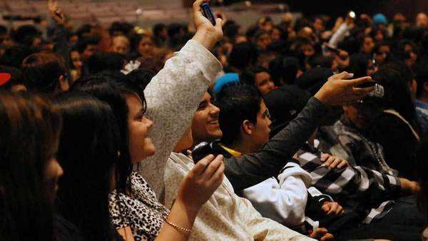 Southwest students are asked to hold up their cell phones at the start of the presentation.