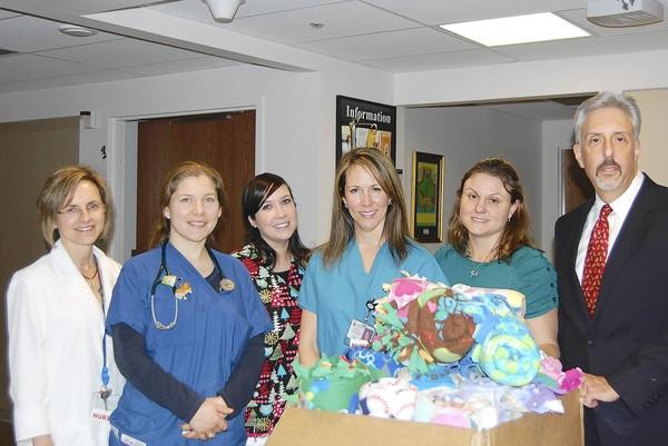 Officials of Morgan Stanley, in Westminster, visited Carroll Hospital Center prior to Christmas to deliver blankets that have been made by employees. From left are Bea Thomas, R.N.C., clinical manager of Carroll Hospital Center's Family Birthplace; Cynthia Roldan, M.D., director of the pediatric program; Laura Grizzell, R.N.; Jennifer Meador, R.N.; Coleen Kramer Beal, associate of the Velnoskey Group at Morgan Stanley; and Douglas Velnoskey, a senior vice president at Morgan Stanley.