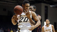 Towson brought a four-game winning streak into its showdown for first place in the Colonial Athletic Association on Saturday against Northeastern. Then it sprinted to a 12-point lead.