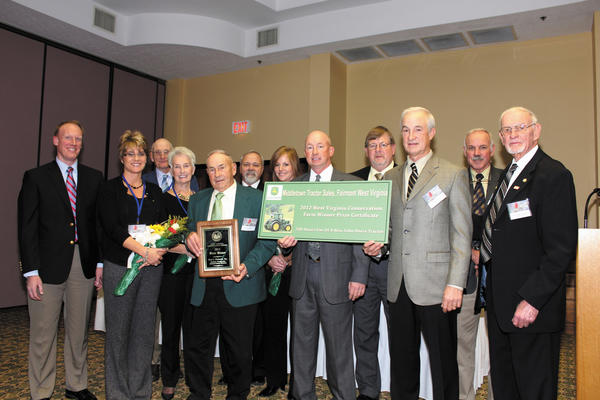 Members of the Butler family are shown with West Virginia state agriculture officials after accepting the award for being named 2012 West Virginia Conservation Farm of the Year earlier this month in Charleston, W.Va.  Pictured are, front row, from left, Jennifer Butler, Ginnie Butler, Bruce Butler Sr., Bruce Butler Jr., Greg Butler and West Virginia Department of Agriculture Commissioner Gus R. Douglass; and back row, Louis Aspey, acting state conservationist with the USDA-Natural Resources Conservation Service; Gary Sawyer, president of the West Virginia Association of Conservation Districts; Alfred Lewis, state executive director of the USDA-Farm Service Agency; Susan Butler; Steve Cronin of Middletown Tractor Sales; and Paul Lewis, assistant director of outreach and community affairs for the WVU Agricultural and Forestry Experiment Station.