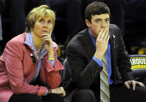 Marquette coach Terri Mitchell and first-year assistant Tyler Summitt watch the action against UConn at the Al McGuire Center in Milwaukee Saturday afternoon.