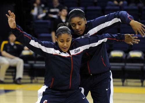 UConn warms up before facing Marquette in Milwaukee.