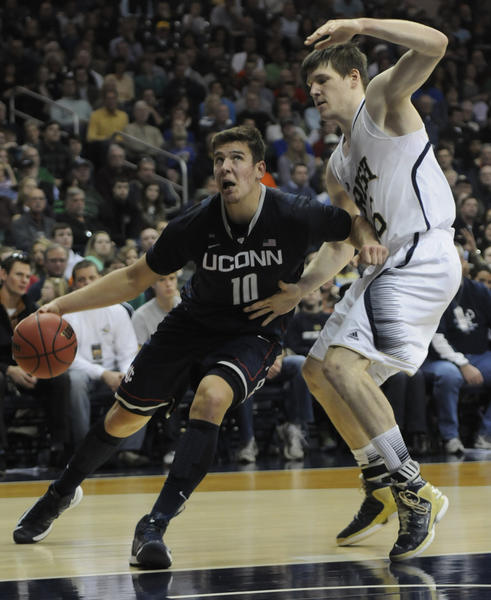 UConn forward Tyler Olander drives to the basket past Notre Dame forward Jack Cooley during the second half.