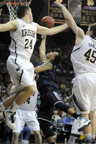 UConn guard Shabazz Napier drives to the basket past Notre Dame guard/forward Pat Connaughton, left, and forward Jack Cooley for two of his game-high 19 points.