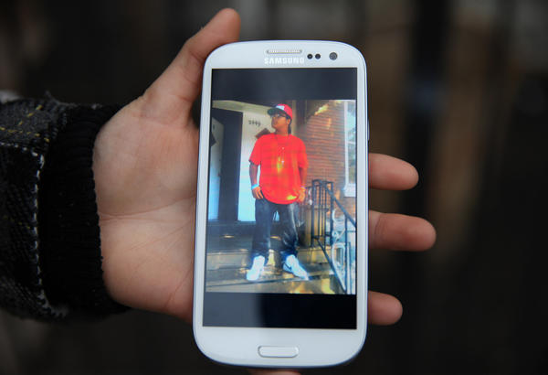 A picture on the cell phone of a family member shows Rey Dorantes, 14, who was shot on the front porch of his home.