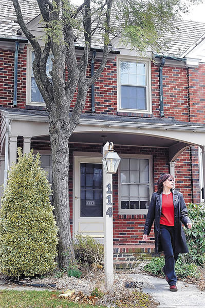 Nancy Shulley leaves the East Irvin Avenue home in Hagerstown that is at the center of her financial nightmare.
