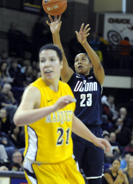 UConn forward Kaleena Mosqueda-Lewis takes a shot as Marquette forward Katherine Plouffe looks to get in position for a rebound during the first haf at the Al McGuire Center in Milwaukee Saturday afternoon. Mosqueda-Lewis led all players with 24 points as the Huskies rolled to an 85-51 victory.