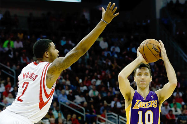 Steve Nash, looking to pass over Houston's Marcus Morris, became just the fifth player in NBA history to reach 10,000 career assists during the Lakers' game against the Clippers Tuesday night.