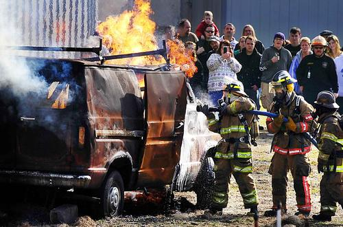 Firefighters demonstrate putting out a vehicle fire Saturday at Washington County Public Schools' Fire and Rescue Academy open house.