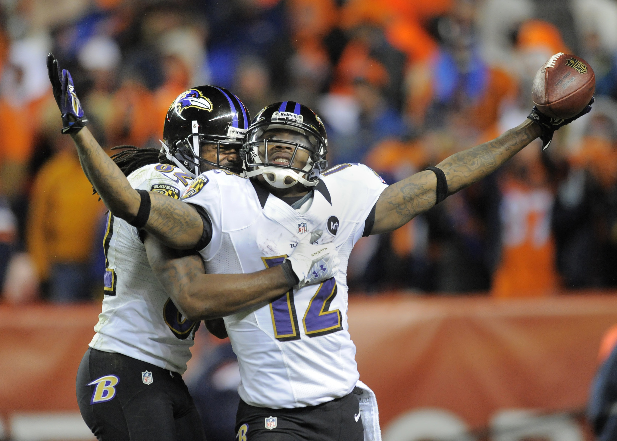 Ravens wide receivers Jacoby Jones, right, and Torrey Smith celebrate after Jones scored on a 70-yard touchdown to tie the game in the final minute of regulation. Kicker Justin Tucker won the game in the second quarter of overtime with a 47-yard field goal, giving the Ravens a 38-35 victory.