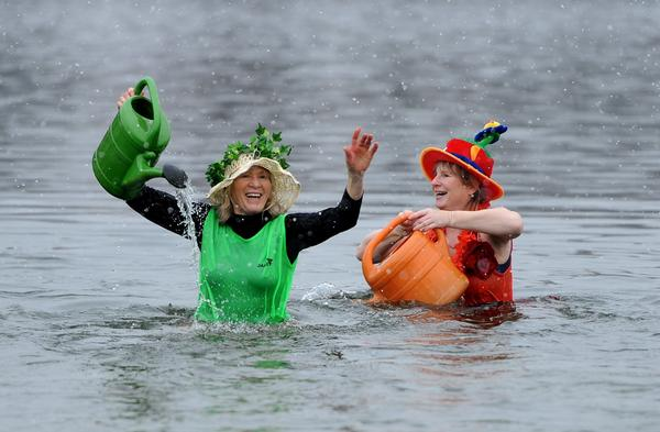 Bathers play in water on January 12, 2013 at Berlin's Oranke lake during a traditional winter swimming.