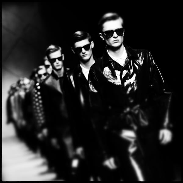 (EDITORS NOTE: Image was processed using Snapseed) Models walk the runway during the Burberry Prorsum show as part of Milan Fashion Week Menswear Autumn/Winter 2013 on January 12, 2013 in Milan, Italy.