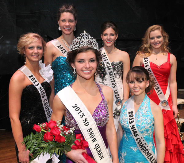 Kendra Woytassek, Miss Aberdeen, center front, was crowned the 2013 South Dakota Snow Queen Saturday night at the Aberdeen Civic Theater. Behind Woytassek are her court: first runner up, Miss Groton Erica Schuster; left, second runner up, Miss Deuel Area Tiara Gibson; third runner up Miss Britton Area Hattie Erickson; fourth runner up Miss Waubay Carly Stoneman and Miss Congeniality Miss Eagle Butte Karmala Bachman. American News Photo John Davis