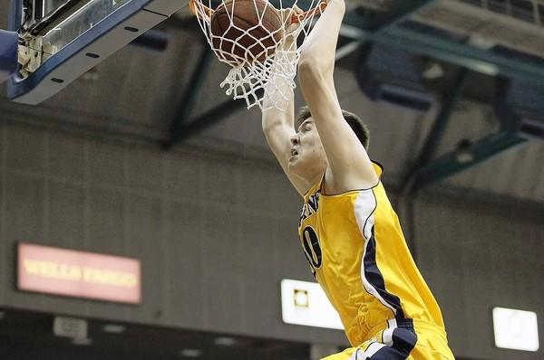 UC Irvine's center Conor Clifford slams one home during a Big West Conference game against Cal State Northridge on Saturday.