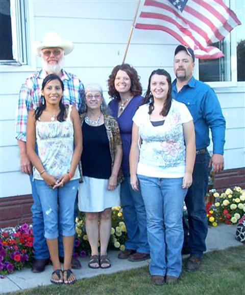 Jim and Jean Mulder of Eureka celebrated their 40th anniversary with their three children and Julia Strikes Enemy, in front, whom they also regard as one of their children. Strikes Enemy was with the Mulders for 10 years.