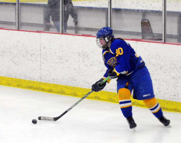 Callie Jorgenson of the Aberdeen Cougars carries the puck during the third period of the Cougars' 1-0 loss to the Oahe Lady Caps in Fort Pierre on Saturday.