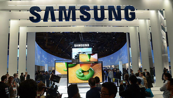 Consumers check products at Samsung booth at the 2013 International CES at the Las Vegas Convention Center on January 10, 2013 in Las Vegas, Nevada. CES, the world's largest annual consumer technology trade show, runs from January 8-11 and is expected to feature 3,100 exhibitors showing off their latest products and services to about 150,000 attendees.AFP PHOTO / JOE KLAMARJOE KLAMAR/AFP/Getty Images ** TCN OUT **