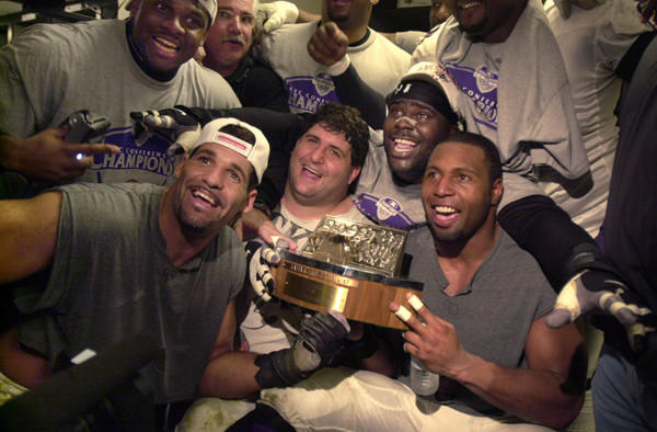 Adalius Thomas, Michael McCrary, Tony Siragusa, Lional Dalton, Rob Burnett and other Ravens celebrate Baltimore's win over Oakland on Jan. 14, 2001 for the AFC title.