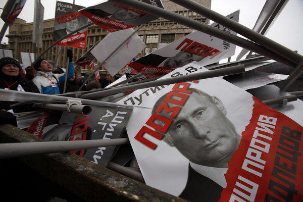 "Thousands of demonstrators opposed to a law banning U.S. families from adopting Russian orphans took to the streets of Moscow with signs showing President Vladimir Putin and other politicians who supported the law with ""Shame"" written on their faces."