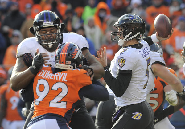 Ravens tackle Bryant McKinnie keeps Elvis Dumervil at bay as Joe Flacco takes to the air in a game seen by the largest audience in 26 years for an AFC divisional match.