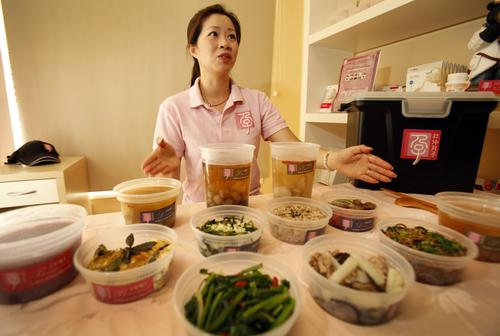 Charlotte Duh, owner of Meal4Mom, shows a few of the herbal soups and stews that she delivers to her postpartum clients from her Temple City studio.